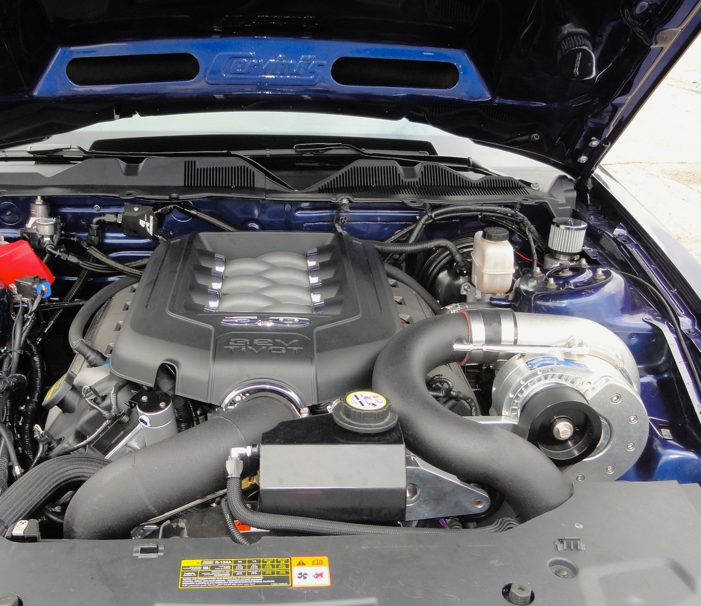 ProCharger Unveils 2011 5.0 Mustang Tuner Kits & Intercooled Stage II Systems at SEMA-procharged_evolution_2011_mustang.jpg