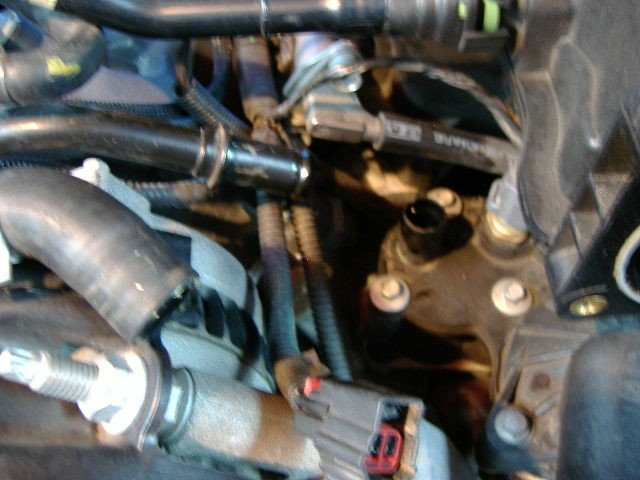 "2005 V6 Mustang thermostat and housing replacement ""how to with pics""-t-stat8-small-hose-out-way.jpg"