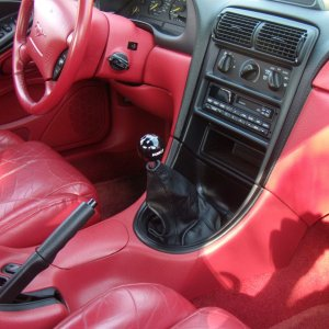 1994 Opal Frost Mustang GT, red leather interior