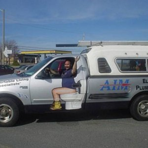 funny-paint-job-plumbing-truck-work-vehicle-advertising