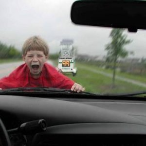 kid-stuck-on-hood-of-speeding-vehicle-funny-drivers-photo